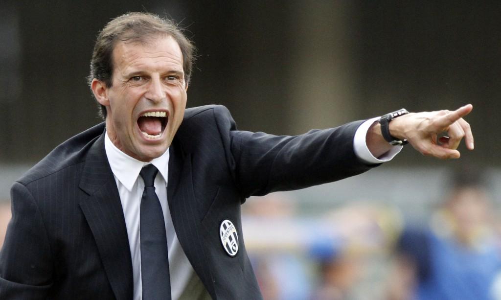 Juventus' coach Massimiliano Allegri shouts during a Serie A soccer match against Chievo Verona at the Bentegodi stadium in Verona, Italy, Saturday, Aug. 30, 2014. (AP Photo/Felice Calabro')