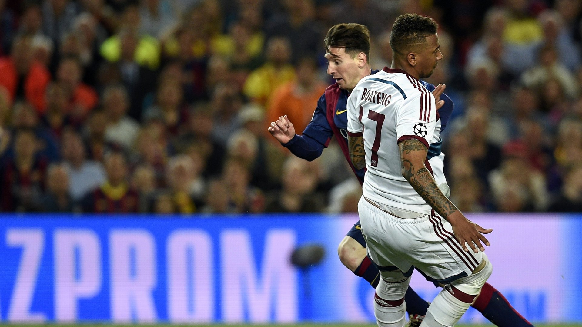 Barcelona's Argentinian forward Lionel Messi (L) vies with Bayern Munich's defender Jerome Boateng (R) during the UEFA Champions League football match FC Barcelona vs FC Bayern Muenchen at the Camp Nou stadium in Barcelona on May 6, 2015. AFP PHOTO/ LLUIS GENE (Photo credit should read LLUIS GENE/AFP/Getty Images)