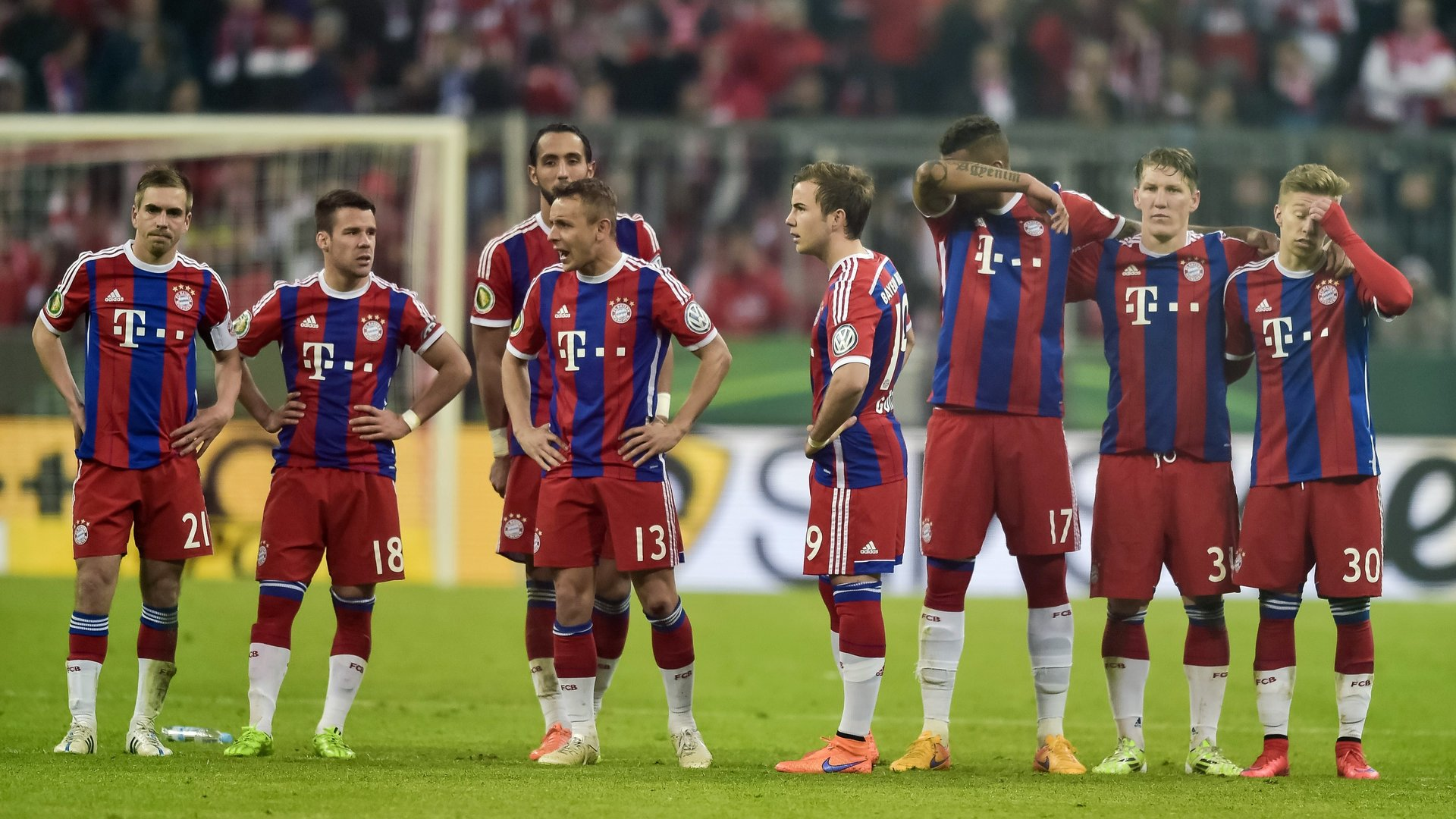 Bayern Munich's players react during the penalty shoot-out of the German Cup DFB Pokal semi-final football match FC Bayern Munich v Borussia Dortmund in Munich, southern Germany, on April 28, 2015. Dortmund won the match 1-3 after penalties. AFP PHOTO / GUENTER SCHIFFMANN +++ RESTRICTIONS / EMBARGO ACCORDING TO DFB RULES IMAGE SEQUENCES TO SIMULATE VIDEO IS NOT ALLOWED DURING MATCH TIME. MOBILE (MMS) USE IS NOT ALLOWED DURING AND FOR FURTHER TWO HOURS AFTER THE MATCH. FOR MORE INFORMATION CONTACT DFB DIRECTLY AT +49 69 67880 (Photo credit should read GUENTER SCHIFFMANN/AFP/Getty Images)