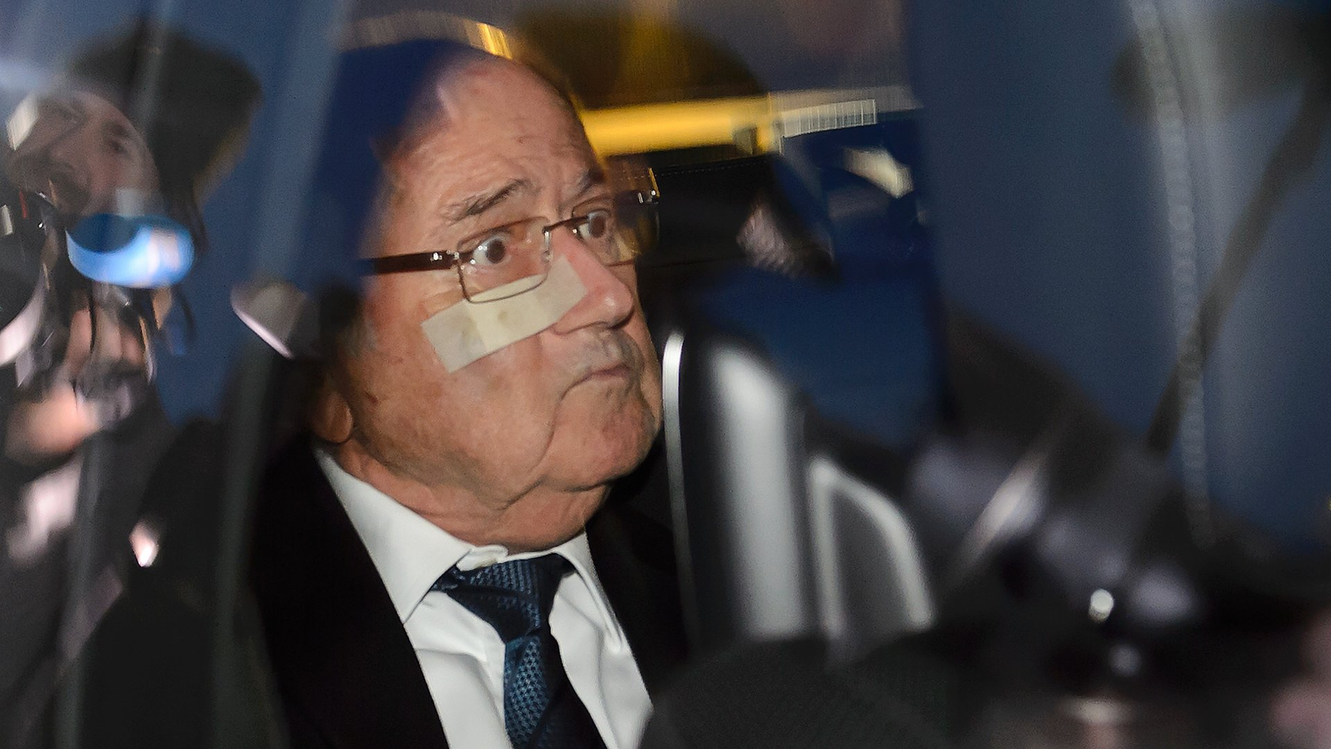 TOPSHOT - Suspended FIFA president Sepp Blatter leaves after a hearing at the FIFA headquarters on December 17, 2015 in Zurich. Suspended Blatter appeared before the world body's ethics judges to answer corruption allegations as Switzerland announced it has frozen tens of millions of dollars in accounts linked to football bribes. / AFP / FABRICE COFFRINI (Photo credit should read FABRICE COFFRINI/AFP/Getty Images)