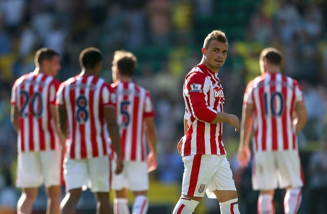 In this Aug. 22, 2015 photo Stoke City's Xherdan Shaqiri  leaves the pitch after the final whistle of the Barclays Premier League match after the English Premier League soccer match between Norwich City and Stoke City at Carrow Road, Norwich, England. (Steve Paston/PA via AP)     UNITED KINGDOM OUT     -   NO SALES      -     NO ARCHIVES