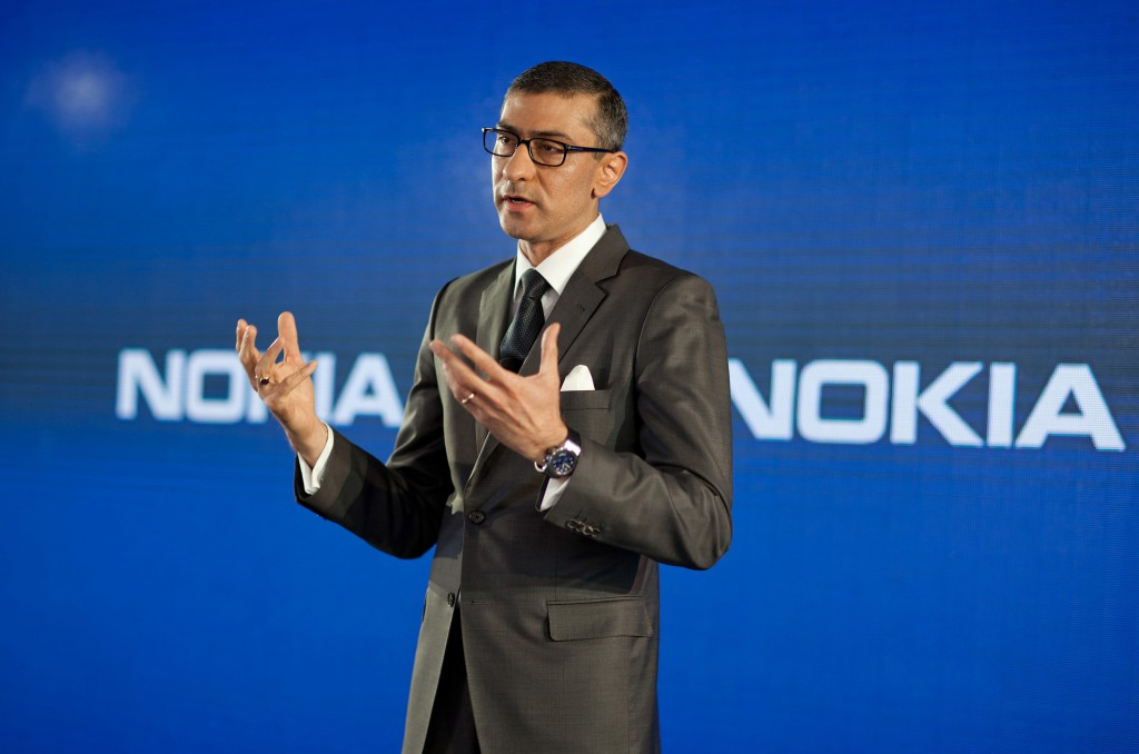 Rajeev Suri, chief executive officer of Nokia Oyj, speaks during a news conference to announce his new appointment at the company's headquarters in Espoo, Finland, on Tuesday, April 29, 2014. Nokia named Suri chief executive officer, picking the head of its networks division to chart the company's future and forecasting a return to sales growth after selling the mobile-phone business to Microsoft Corp. Photographer: Henrik Kettunen/Bloomberg *** Local Caption *** Rajeev Suri